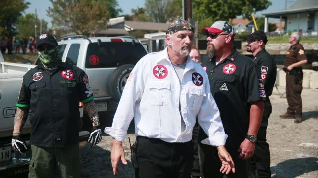 Members of the Ku Klux Klan including Richard Preston imperial wizard of the Baltimorebased Confederate White Knights of the Ku Klux Klan prepare to...