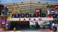 Members of the media enter to the Legoland Japan theme park in Nagoya Japan on Friday March 17 Signage is displayed outside the entrance to the...
