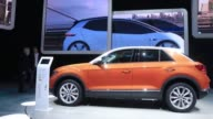 Members of the media view the Volkswagen AG TRoc compact sportutility vehicle ahead of the IAA Frankfurt Motor Show in Frankfurt Germany on Monday...