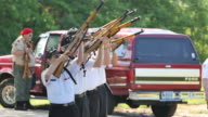 Members of the Monroe County Honor Guard fire three volleys in a 21 gun salute to honor fallen members of the military during Memorial Day ceremonies...