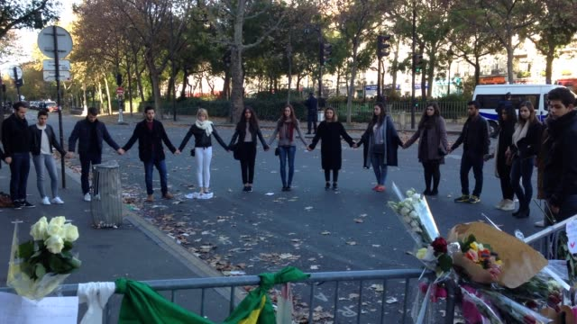 Members of the public gather to lay flowers and lit candles near the 'Le Bataclan' theatre 2 days after the terrorist attacks Friends of victims...