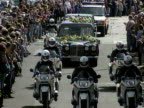 Members of the public throw flowers onto the hearse containg Princess Diana's coffin as the funeral cortege leaves Westminster Abbey 06 September 1997
