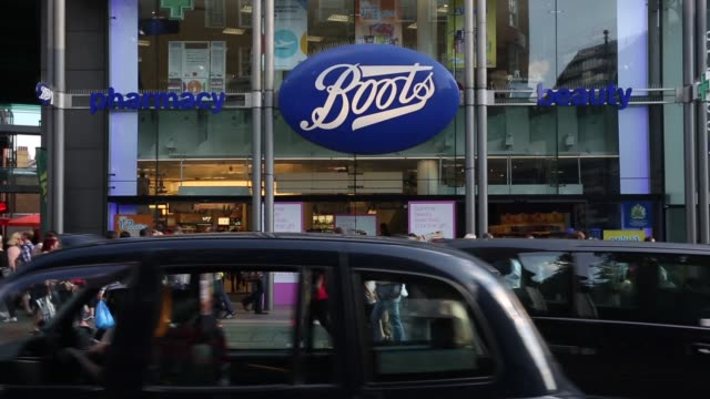 WS Members of the public walk past a branch of Boots the chemist on Oxford Street on August 6 2014 in London England US pharmacy chain 'Walgreens'...