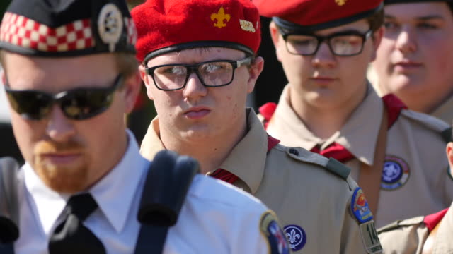 Members of the Southern Pipe and Drum Corp and Boy Scouts from Bloomington Troop 148 march during Memorial Day ceremonies at Valhalla Memory Gardens...