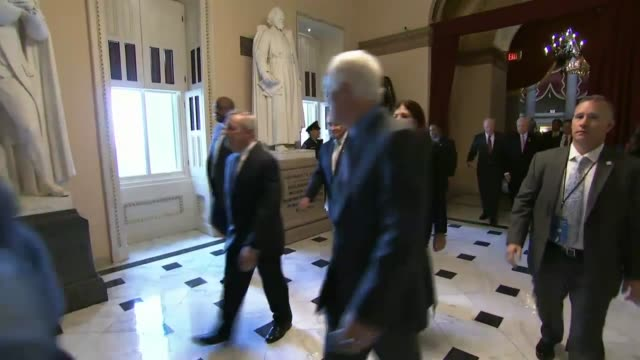 Members of the United States Senate walk together to the hall of the House for a Joint Meeting to receive a speech by His Holiness Pope Francis