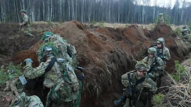 Members of the US 173rd Airborne Brigade discuss the outcome of a simulated attack during the Iron Sword multinational military exercises on November...