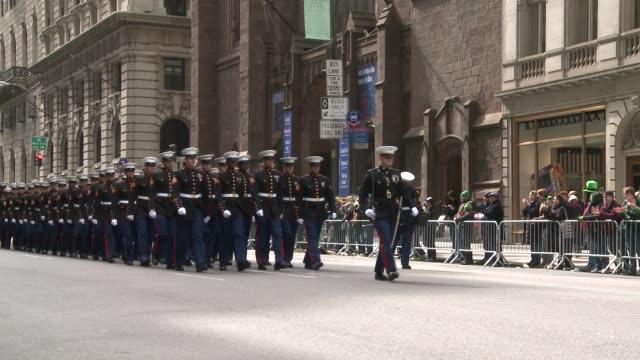 Members of the US Marine Corps march up 5th Ave during the parade