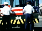 MS Members of the US Military standing at ceremony at Hickam Air Force Base/ WS ZO PAN US Military members ceremoniously unloading US flagdraped...