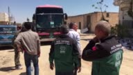 Members of Turkish Humanitarian Relief Foundation IHH distribute emergency relief materials to Syrian opposition fighters and civilians who have left...