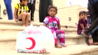 Members of Turkish Red Crestent distribute humanitarian aid to Anbar refugees who fled their homes due to the violence of Daesh on May 28 2015 in...