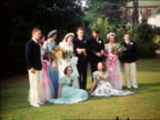 1940 members of wedding party posing for photographer outdoors / Maplewood, NJ / home movie