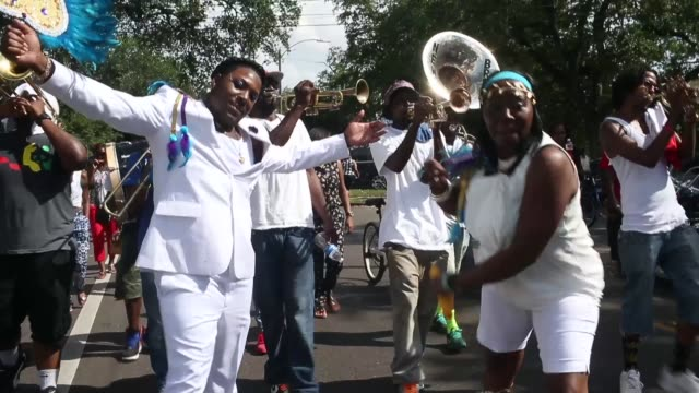 Members participate in the Original Big 7 Social Aid and Pleasure Club 'second line' parade on May 10 2015 in NewOrleans Louisiana Traditional second...