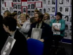 Human Rights court judgement ITN Relatives of dead IRA men applauding at press conference Relatives holding photographs of dead IRA men TGV Press...