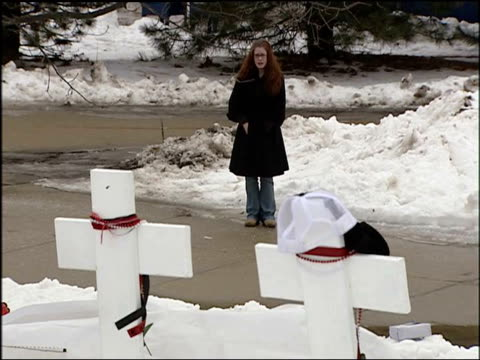 Memorial for the victims of the shooting at Northern Illinois University Girl Standing At NIU Shooting Memorial on February 15 2008 in DeKalb Illinois