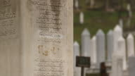 A memorial where the word 'genocide' has been removed by the local council in a Muslim cemetery in Visegrad Bosnia scene of the Visegrad massacres