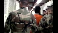 Men accused of planning 9/11 attacks plead guilty at Guantanamo Bay pretrial hearing TX Guantanamo Bay Camp XRay INT Shackled prisoner wearing orange...