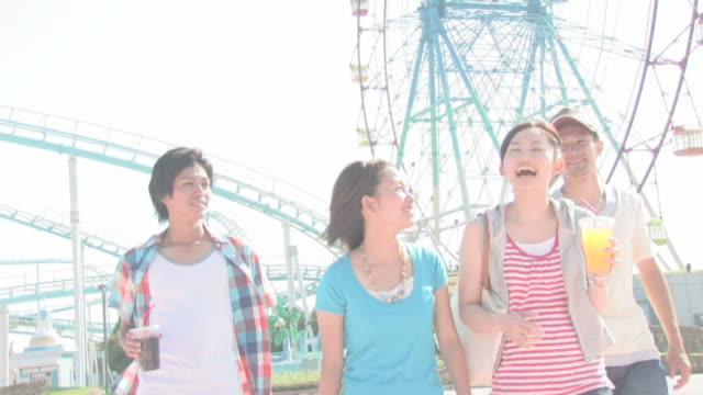 Men and women enjoying themselves in amusement park