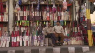 Men at Cricket bat store