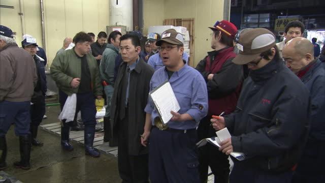 MS PAN Men auctioning tuna, Tsukiji Fish market, Tokyo, Japan