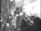 1920 REENACTMENT Men building Noah's ark, hammering and sealing the exterior