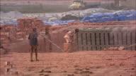 MS, Men carrying bricks at outdoor factory, Bangladesh
