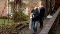 Men carrying front door from flat of Joanna Yeates along for forensic testing