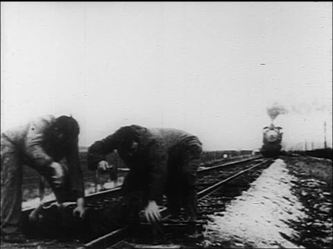 B/W 1913 2 men (1 Mack Sennett) carrying Mabel Normand from tracks narrowly escaping oncoming train