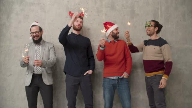 Men Christmas Fun Infront Of Concrete Wall