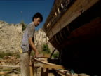 Men creating a reconstruction of the biblical Noah's Ark.