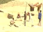 Men digging at excavation site Jordan