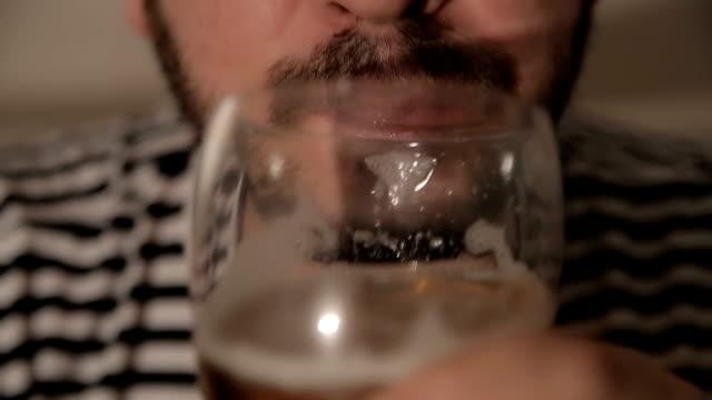 Men drinking beer,close up
