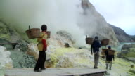 MS PAN Men extracting sulfur from the Ijen volcano complex / Ijen, Java, Indonesia