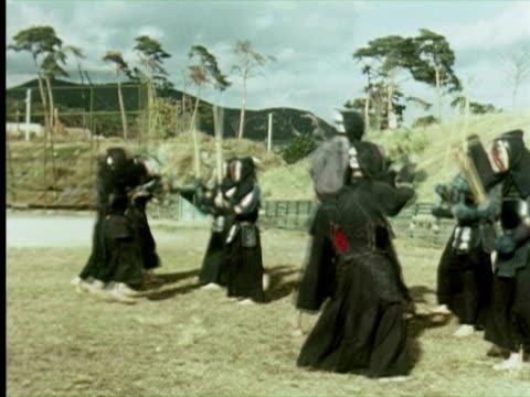 WS PAN Men fighting with sticks, Tokyo, Japan / AUDIO