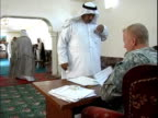 Men giving forms to US soldiers recruiting volunteers for Concerned Local Citizens program / Haswa Iraq / AUDIO
