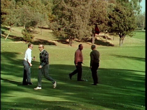 1970 MONTAGE Men golfing at Hillcrest Country Club in Century City, Los Angeles, California, USA, AUDIO