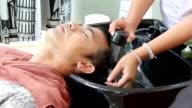 men hair washing by women