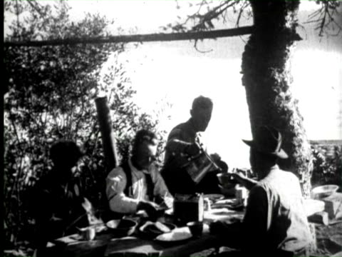 B/W Men having luch and enjoying camp life on red eagle lake  Audio / Montana, United States