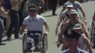 MS PAN Men in wheel chairs start race by spectators at boston marathon  / Boston, Massachussets, United States