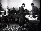 1915 B/W WS Men in workshop making prostheses for war victims/ Russia