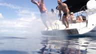 SLO MO Men Jumping Into The Sea