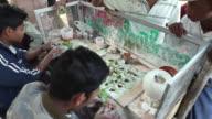 MS HA Men making betel nut chews / Burma