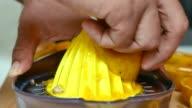 men making orange juice