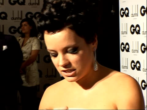 Red carpet interviews **TO ENGLAND London Royal Opera House INT Lily Allen wearing fullskirted strapless grey patterned Dolce and Gabbana balldress...