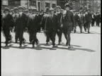 Men officers Theodore Roosevelt standing in reviewing stand Street parade of civilian draftees lines marching w/ soldier on end MS Theodore Roosevelt...