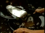 Men pan gold particles mixed with mercury from one pan to another gradually separating Alta Floresta Brazil 1993