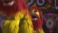 Men perform a traditional Chinese lion dance at a festival in Beijing.