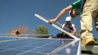 MS Men placing solar panel on the frame / Greenfield, Massachusetts, USA