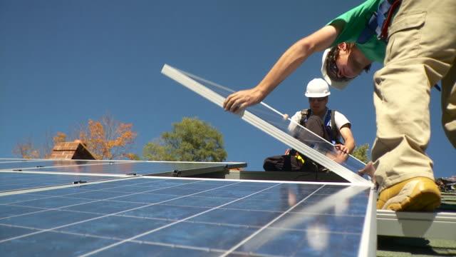 MS Men placing solar panel on the frame / Greenfield, Massachusetts, USA
