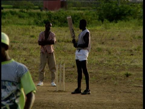 Men play cricket Windward Islands