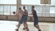 Men Playing Basketball Indoor 2 on 2
